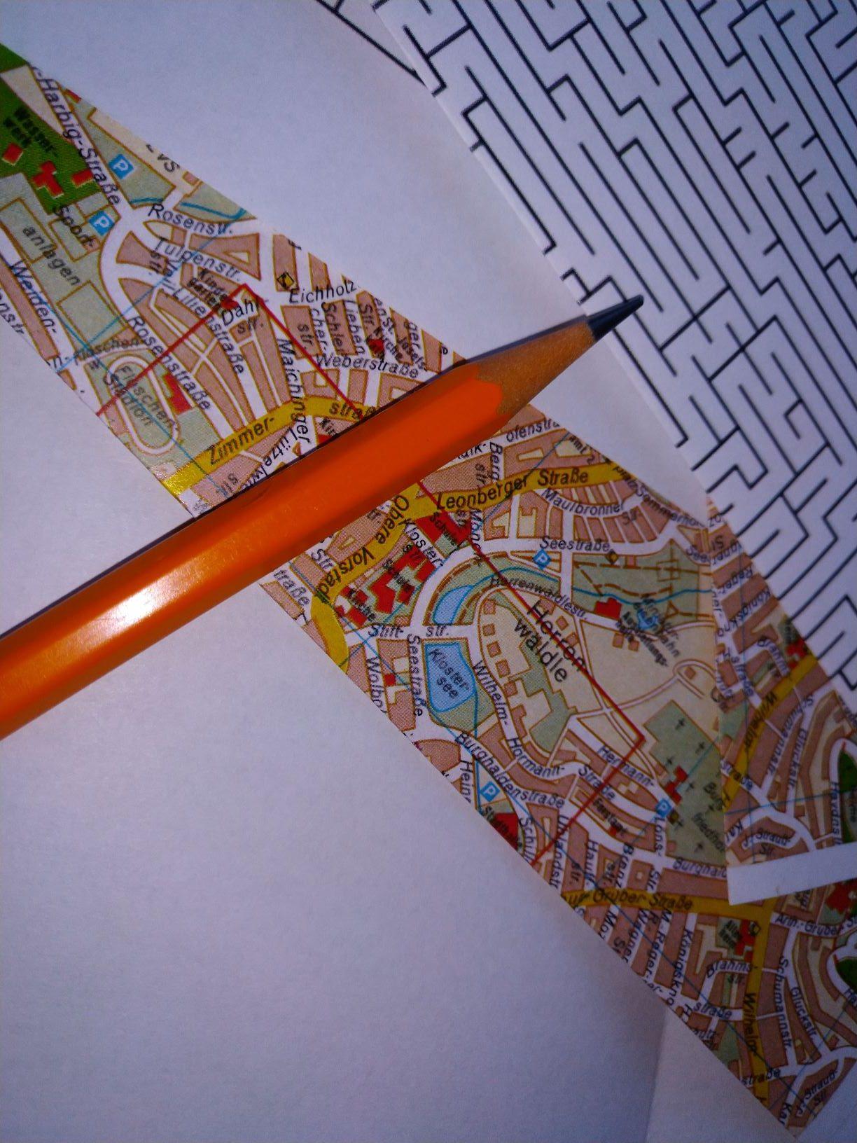 Rätsel, Karte und Stift